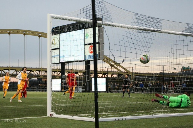 Kevin Kerr finishes penalty shot that turned the tide of the match in 42nd minute.  (Photo courtesy of @TKO_Photos)