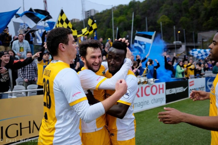 Vini Dantas and Stephen Okai celebrate Kevin Kerr's goal in front of the Steel Army. (Photo courtesy of Paul Wintruba)